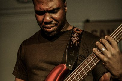 Etched on Derrick Hodge's bass was love, respect, and other virtues. Photo Credit: Jérôme Brunet