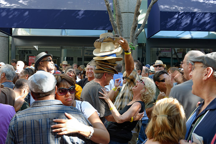 People were losing their hats in the crowd! Cheers to this creative couple for becoming their own festival beacon.Photo Credit: Bruce Fram